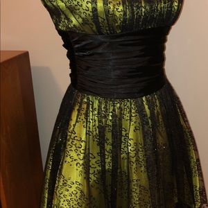 Dresses & Skirts - Yellow under skirt with black lace over skirt.
